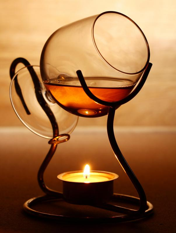 It is often recommended to warm brandy with a candle.