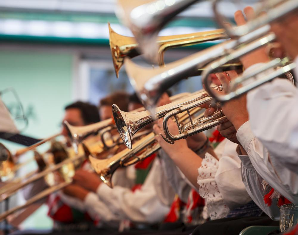 Brass bands usually include several different kinds of horns, as well as trombones.