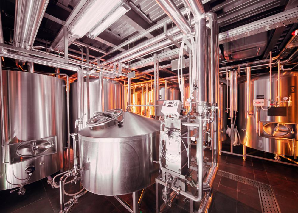 Sodium hydroxide is used to clean large vats and tanks in breweries.
