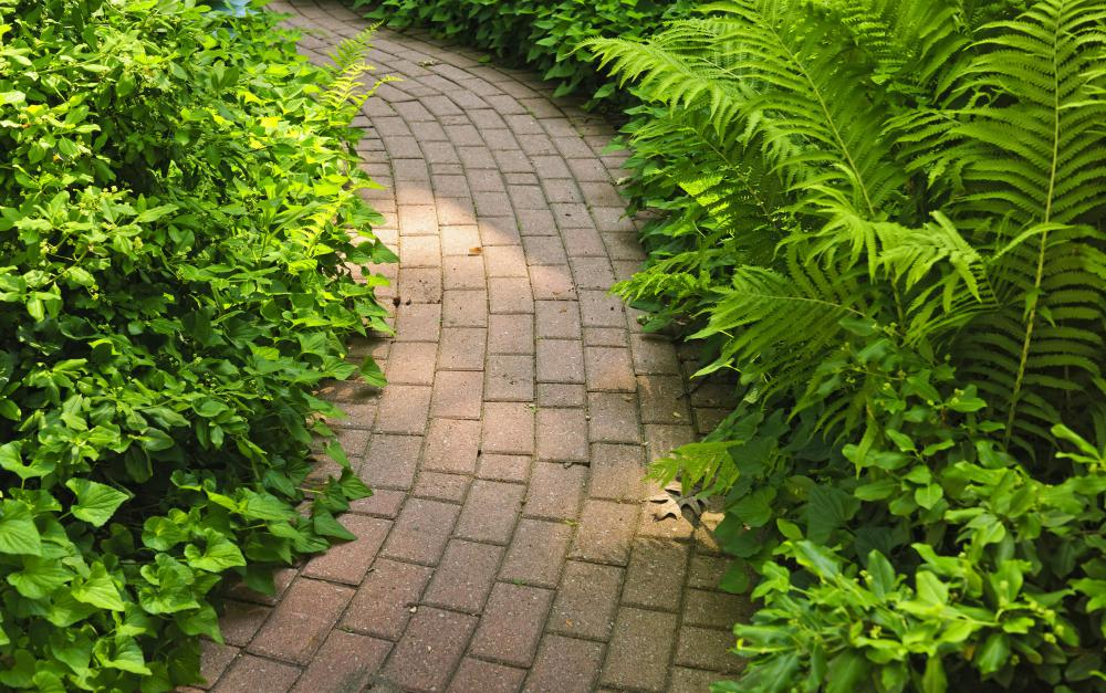 Before laying down pavers, clean the concrete to make sure it is free of any debris.