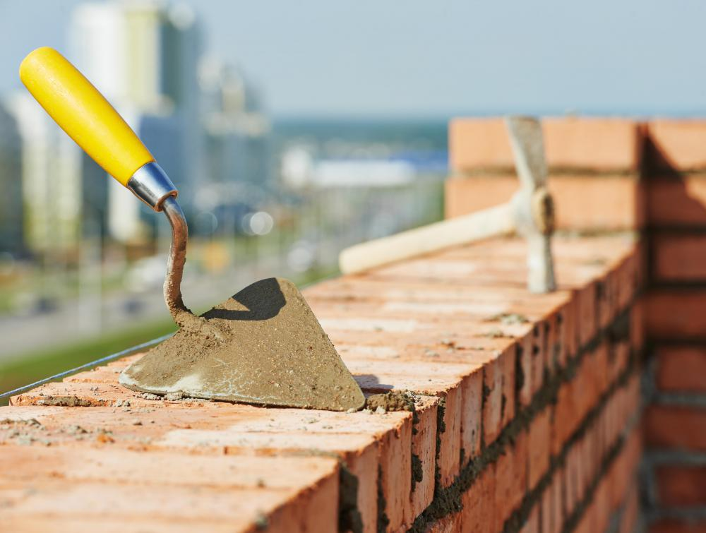 A brick trowel is the tool used to spread concrete or mortar when laying bricks.