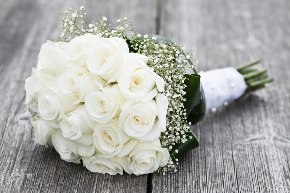 A wedding consultant can help arrange a bridal bouquet.
