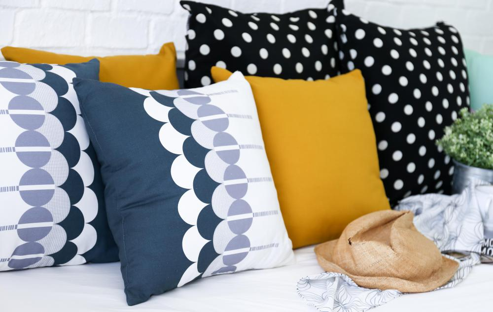 Throw pillows can help incorporate paint colors into a room.