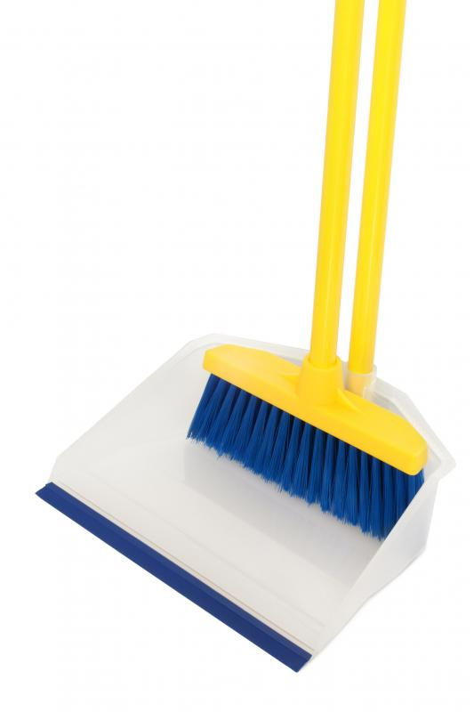 A housekeeping manager purchases supplies such as brooms and dustpans.