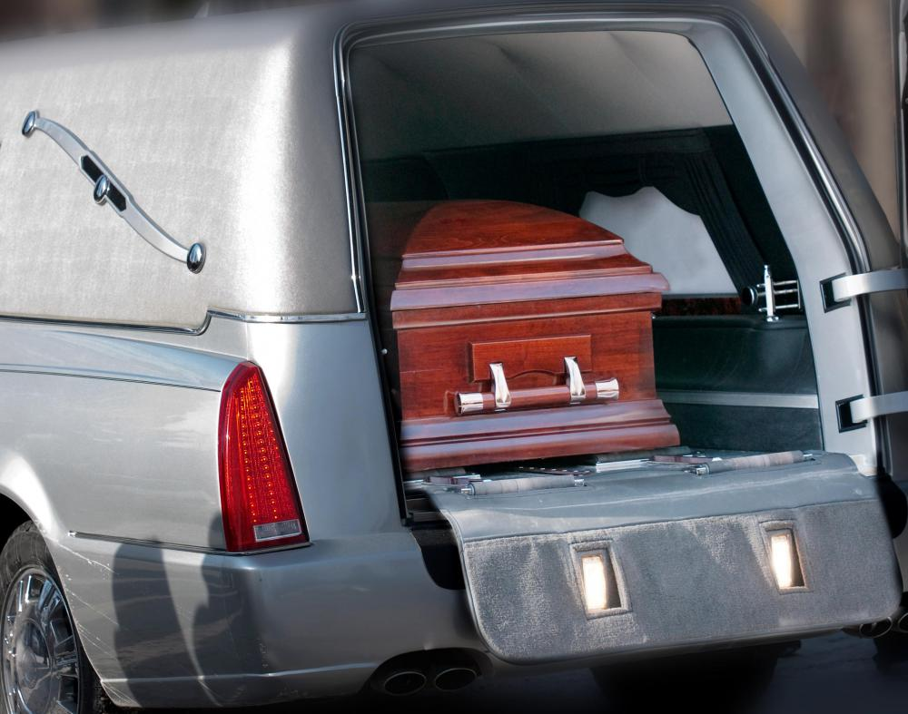 A cemetery caretaker makes preparations for when a casket arrives.