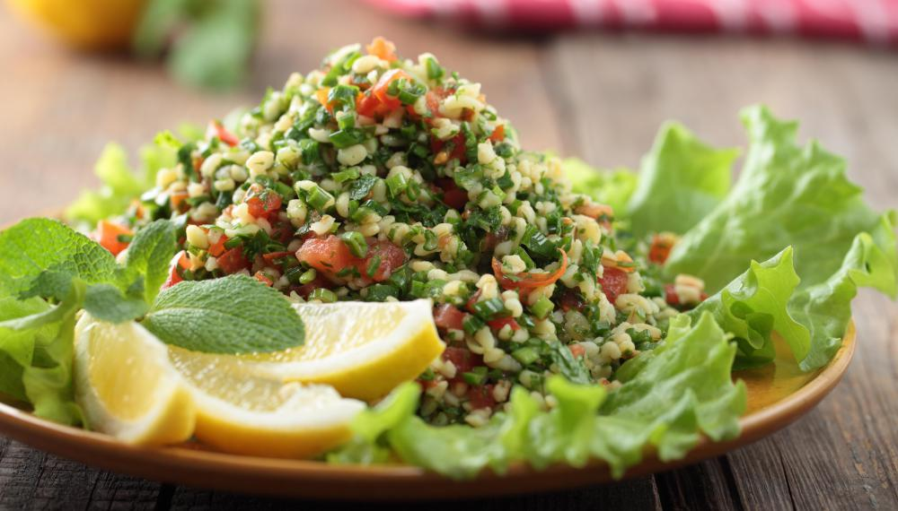 Tabbouleh is a Middle Eastern salad made with bulgur wheat and other ...
