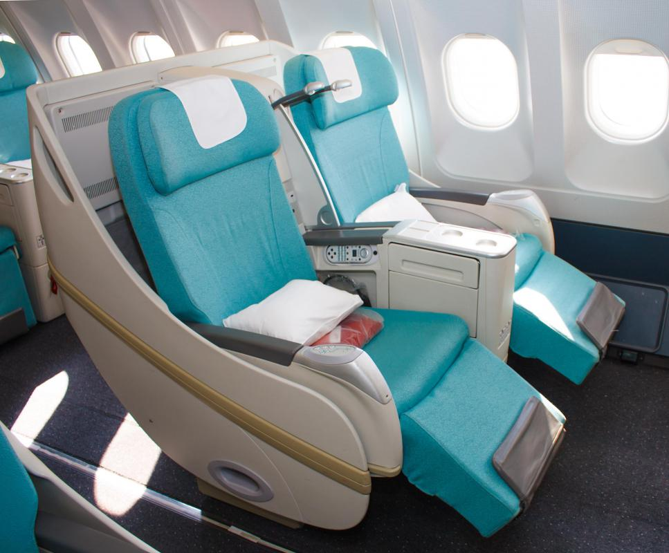 Business class on an airplane tends to have more room than coach seating.