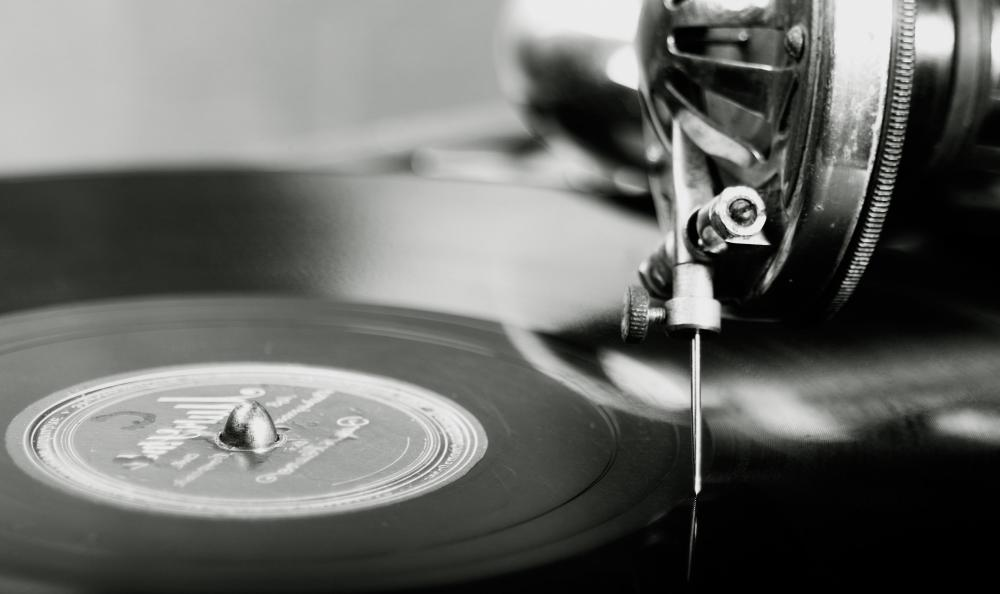 A phonograph uses a stylus that fits into the groove of a record to produce sound as it turns.