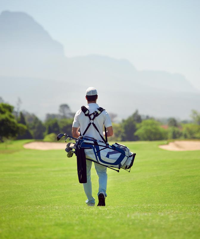Some golfers hire caddies who carry the golfer's bag and clubs across the course.