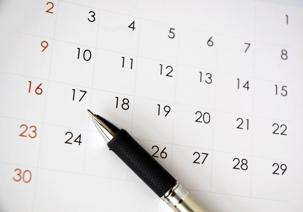 Office receptionists often make appointments on a calendar for clients.