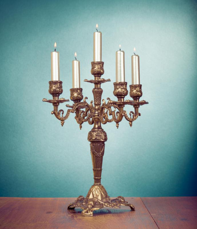 Candelabras may be featured in a shabby chic bedroom.
