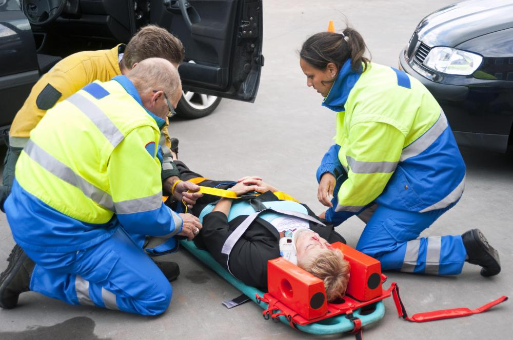 An emergency care assistance may be required to help extricate and carry an injury patient from the accident scene into the ambulance.
