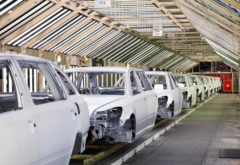 a production operator works as part of an assembly line to create products such as cars - Production Operator