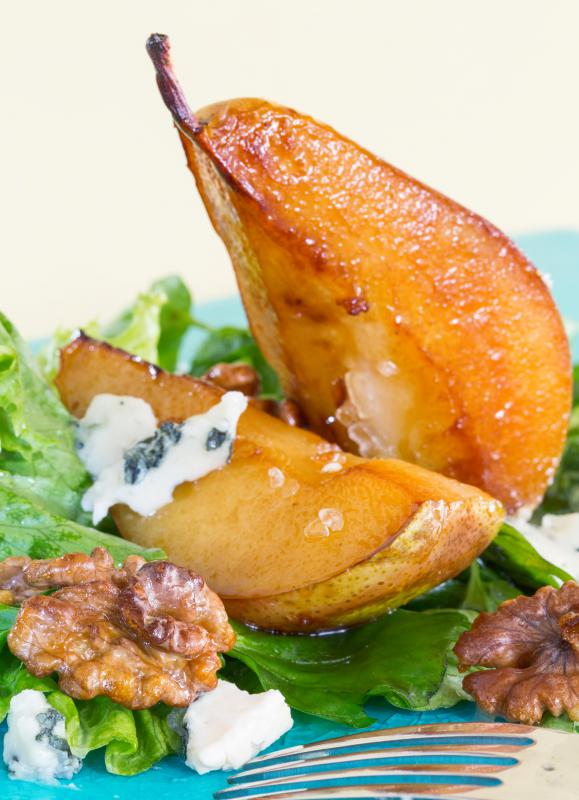 A caramelized pear over lettuce.