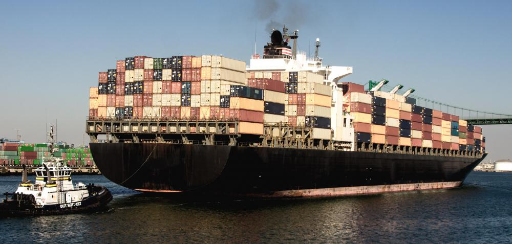 Large cargo ships must be scheduled for loading and unloading in port.