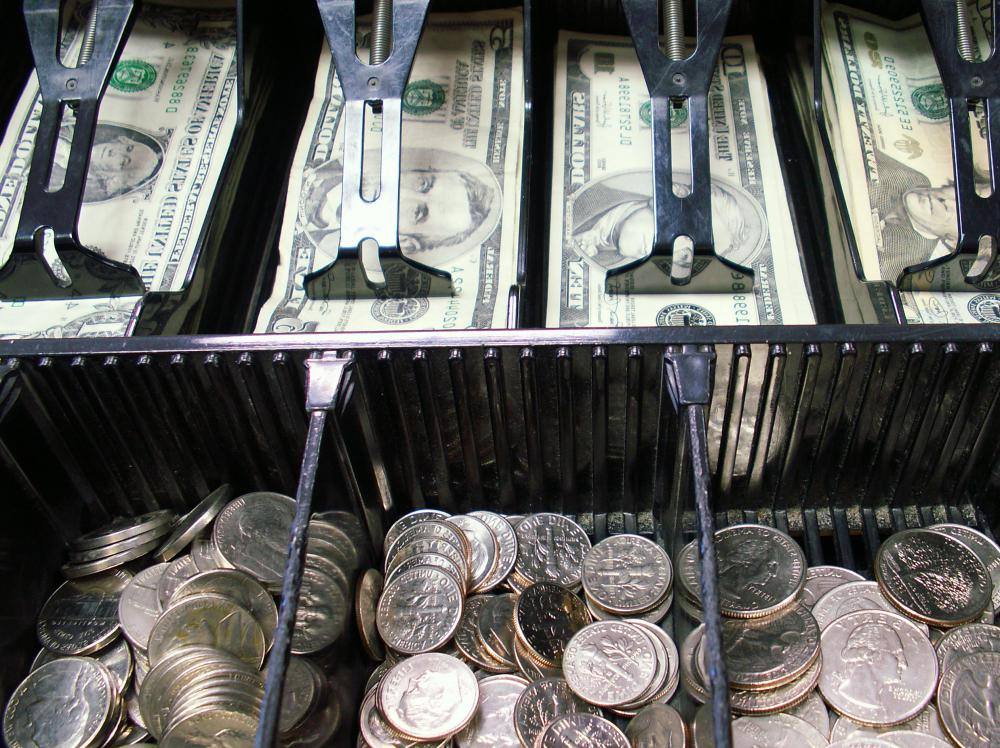 Supermarket cashiers may be required to maintain their cash drawer at an appropriate level of bills and coins.