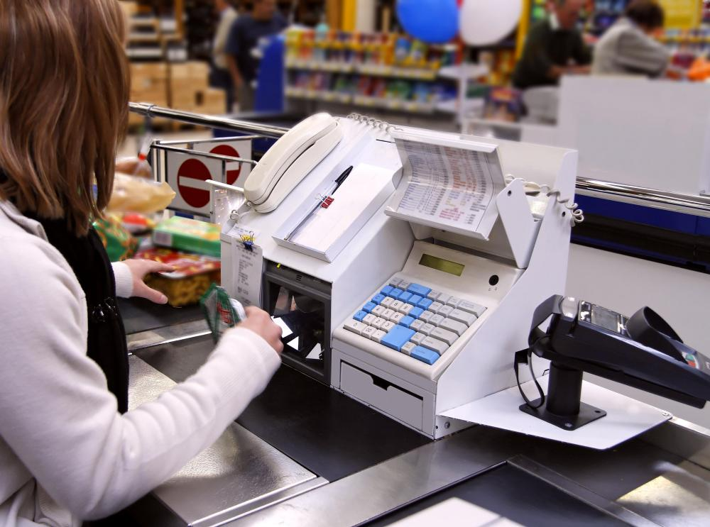 A cashier totals up a customer's purchases.