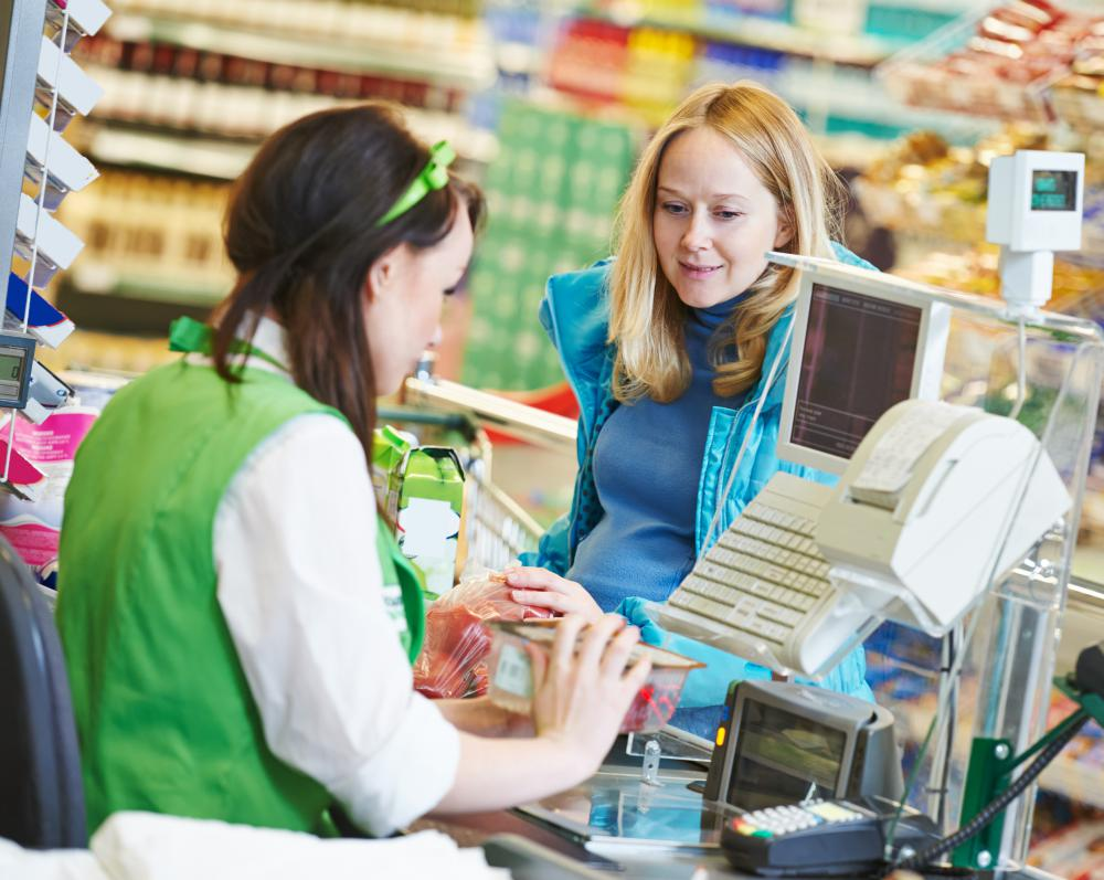 Supermarket cashiers scan customers' items and coupons, collect their money, distribute receipts and change and, often, bag the customer's groceries.