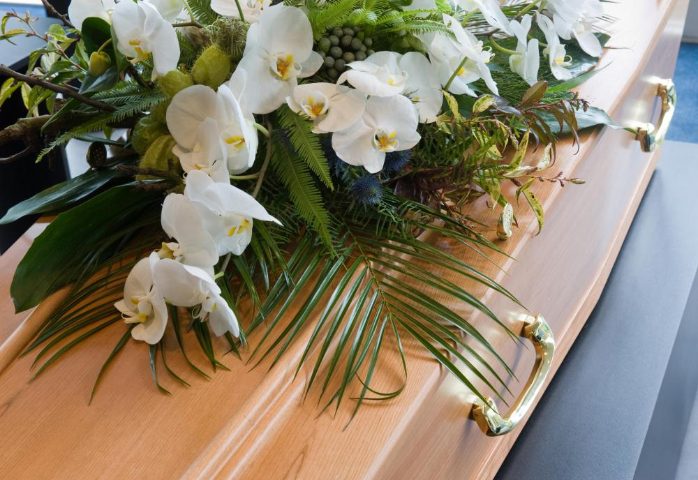 Floral designers may create arrangements for funerals.