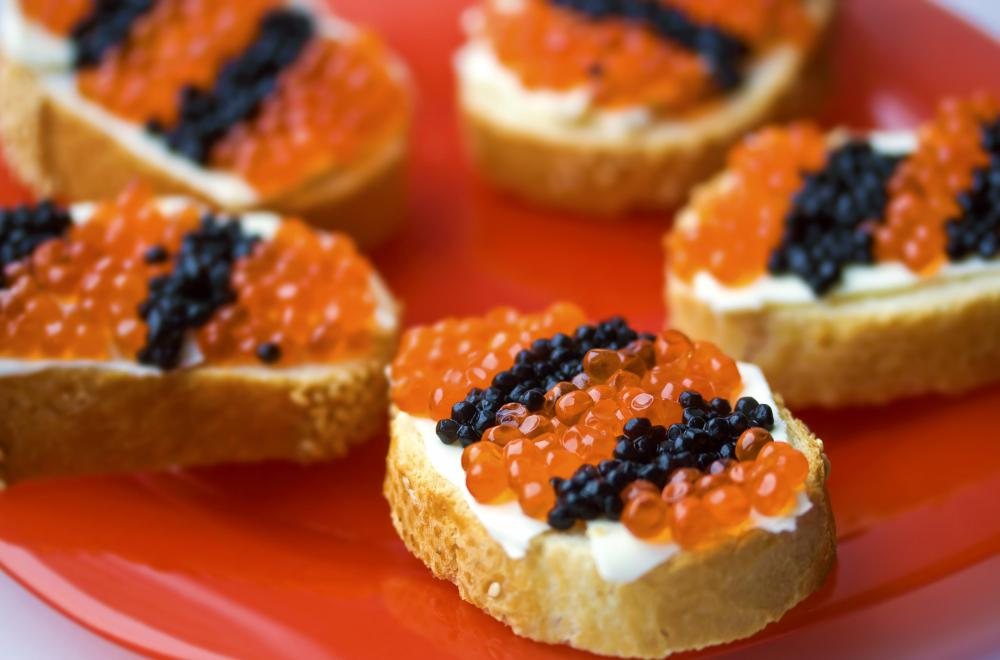Caviar spoons can be used to spread the caviar on bite-sized toast slices.