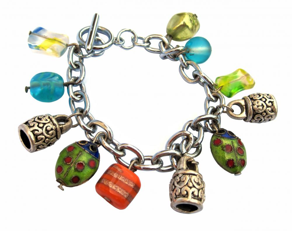 What is a charm bracelet with pictures a charm bracelet with tiny ladybugs and other small colorful charms mozeypictures Gallery