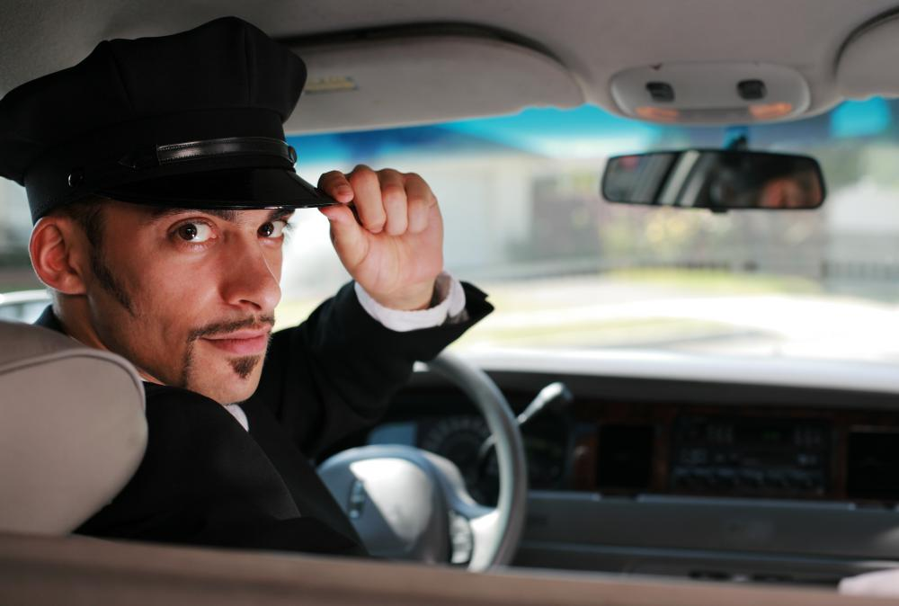 A chauffeur refers to an individual who drives people around for a living.