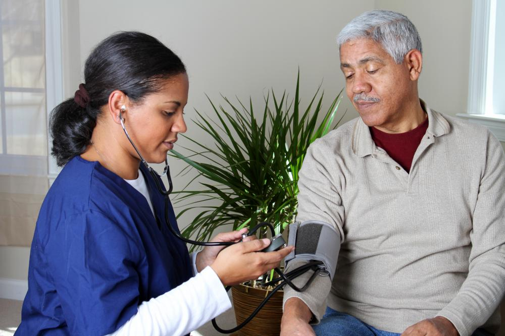 A medical professional checks a man's blood pressure. Acebutolol can be used to treat high blood pressure.