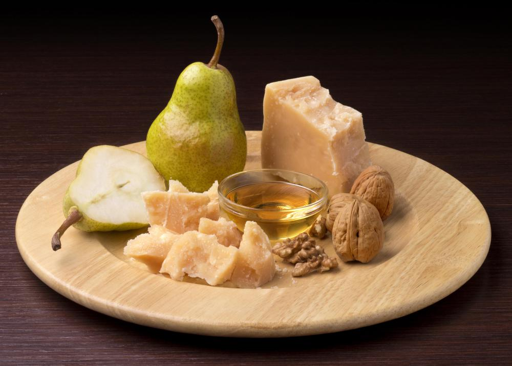 A seasonal platter with walnuts, pears, and cheese.