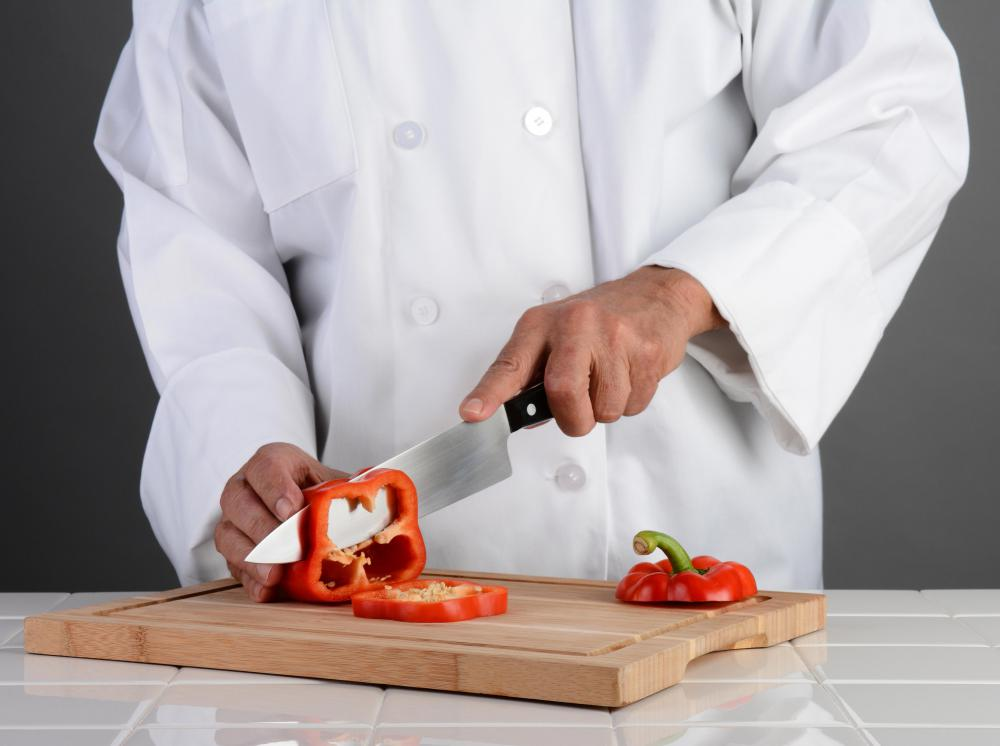Chef using a hollow ground blade.