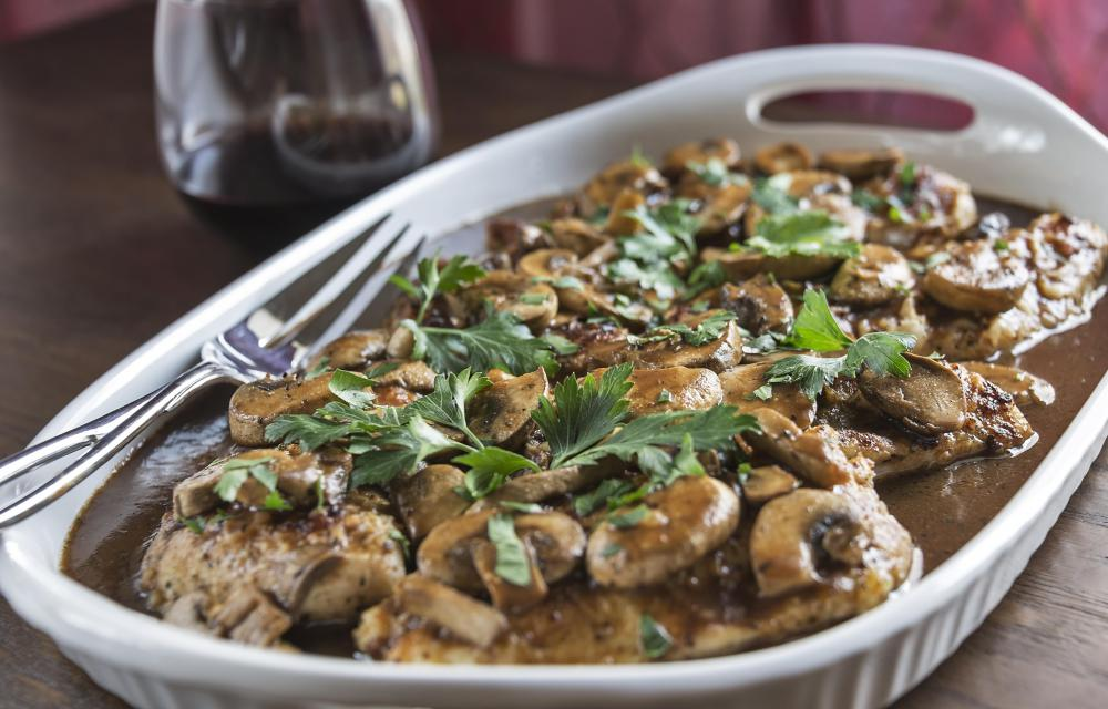Chicken Marsala simmered with wine and mushrooms.