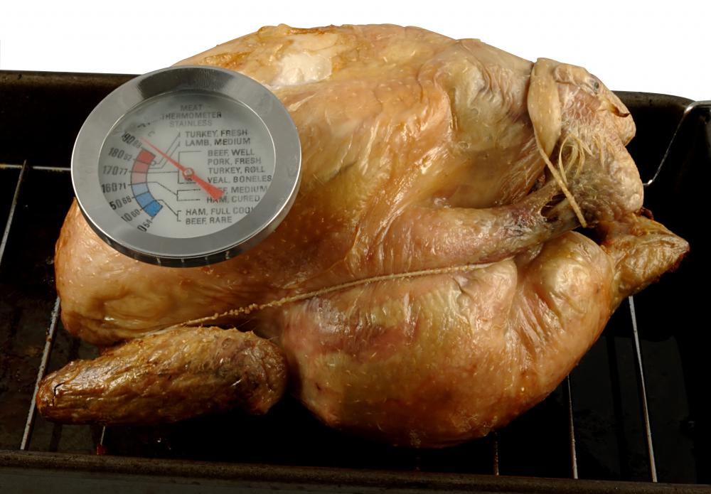 An oven proof meat thermometer remains in the meat while it is cooking.