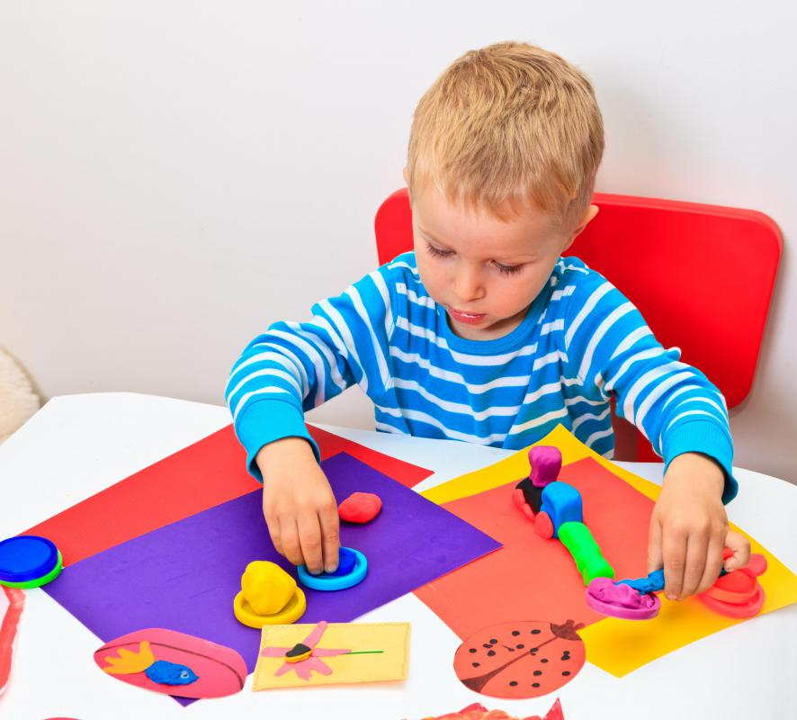 A trauma therapist may use art therapy to communicate with small children.