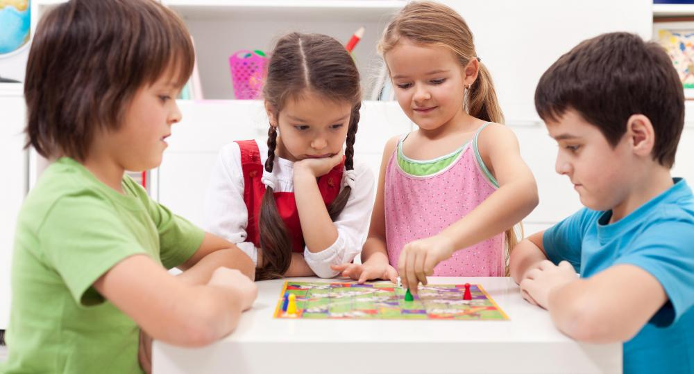 Some board games are motor skill toys that encourage children to use their brain and their hands at the same time.