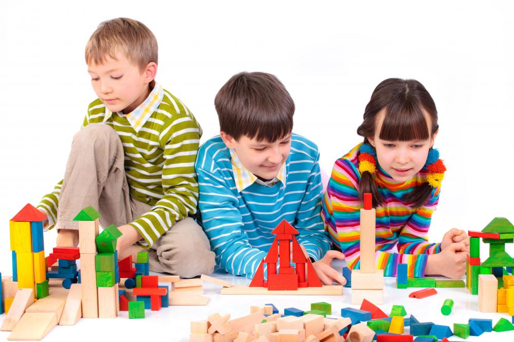Therapy for children might involve group play.