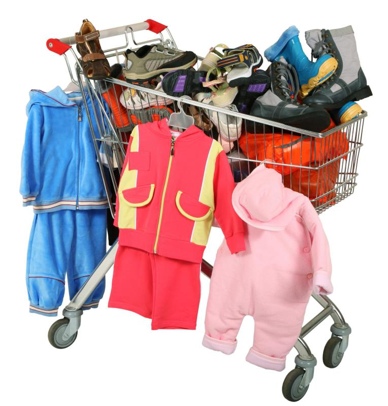 A shopping cart full of children's clothing, including some made of polyester yarn.
