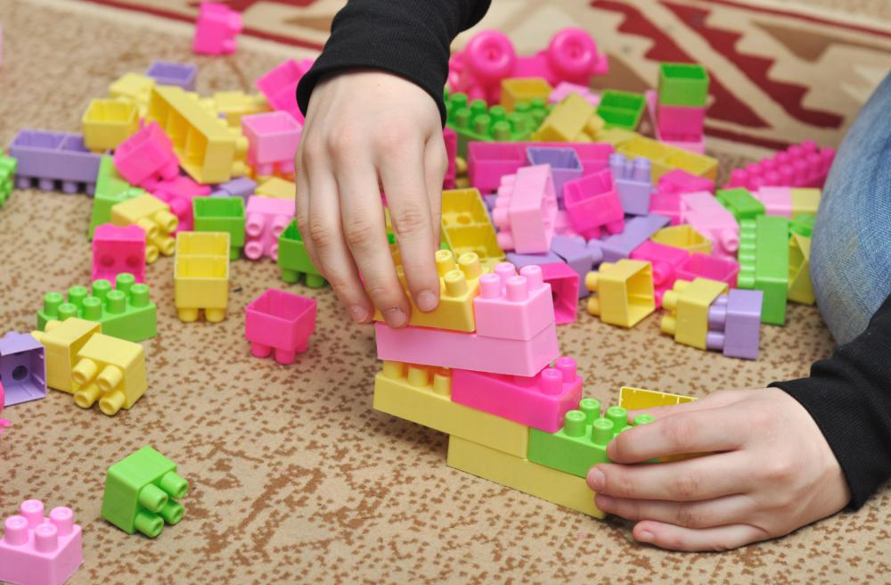 Building blocks can help older children develop gross and fine motor skills.