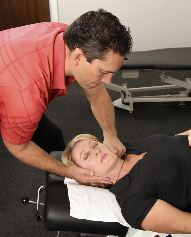 A chiropractor sometimes uses only his hands to adjust a patient's neck, though he might also use specialized tools.