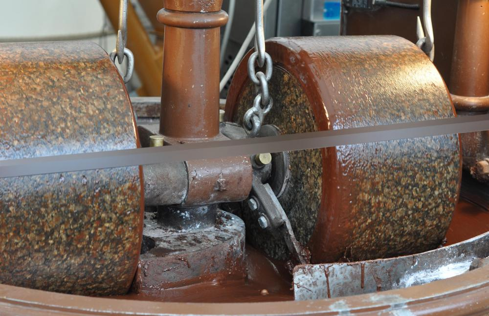 Conche machines are used to grind course particles of chocolate.