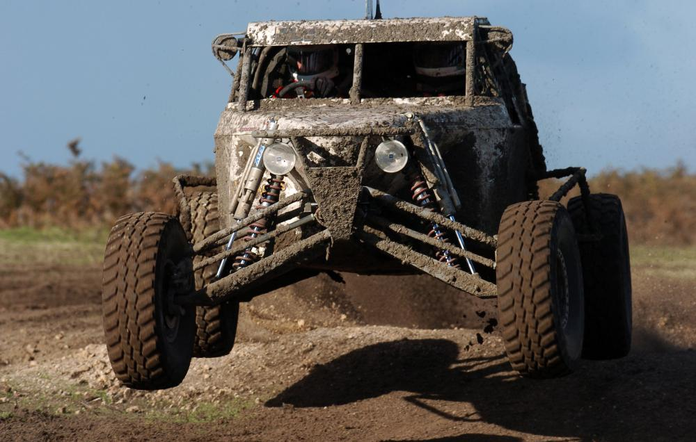 Mud tires are often seen on specialized vehicles, like a dune buggy.