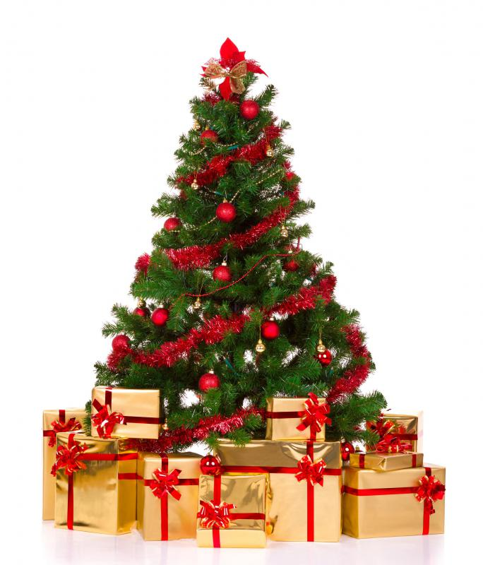 a christmas tree with wrapped presents underneath - Simple But Elegant Christmas Tree Decorations