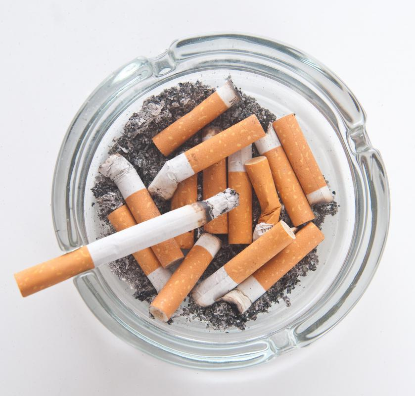 Smoking cigarettes can contribute to bad breath.