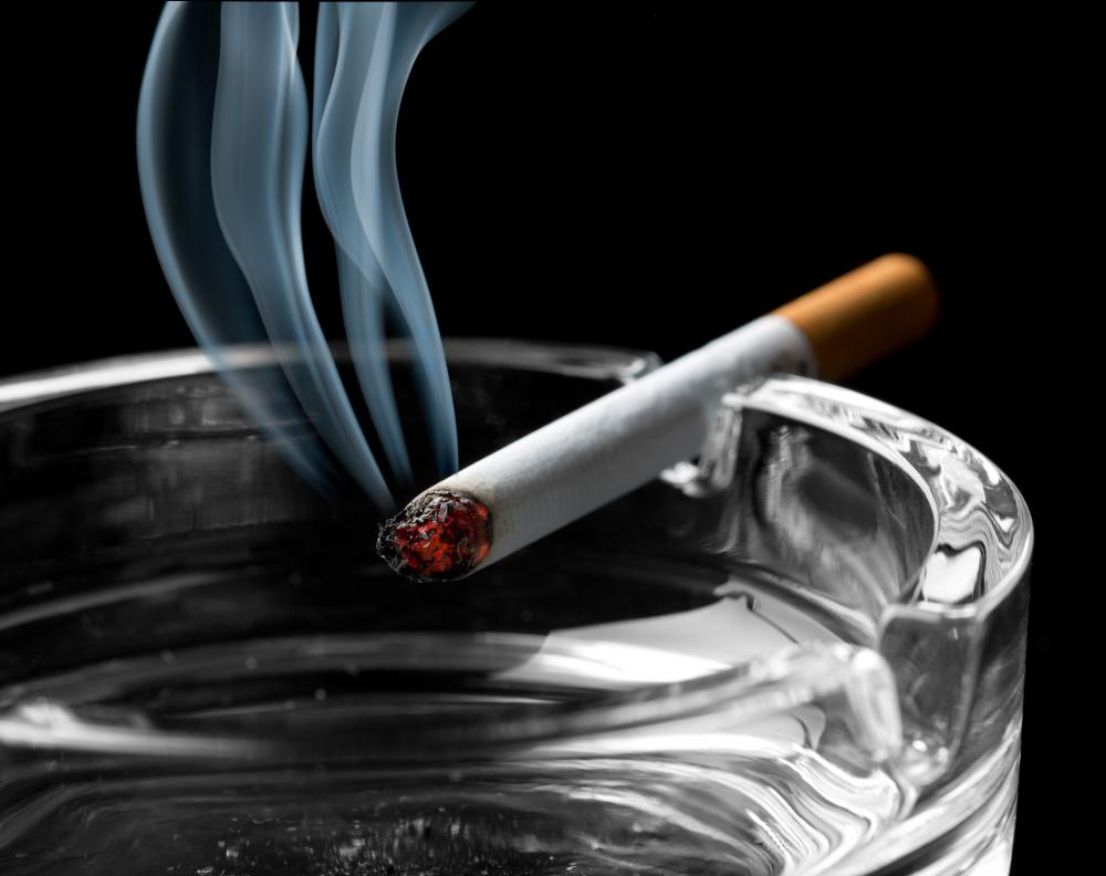 Oral cancers from tobacco use can cause blood in a person's saliva.