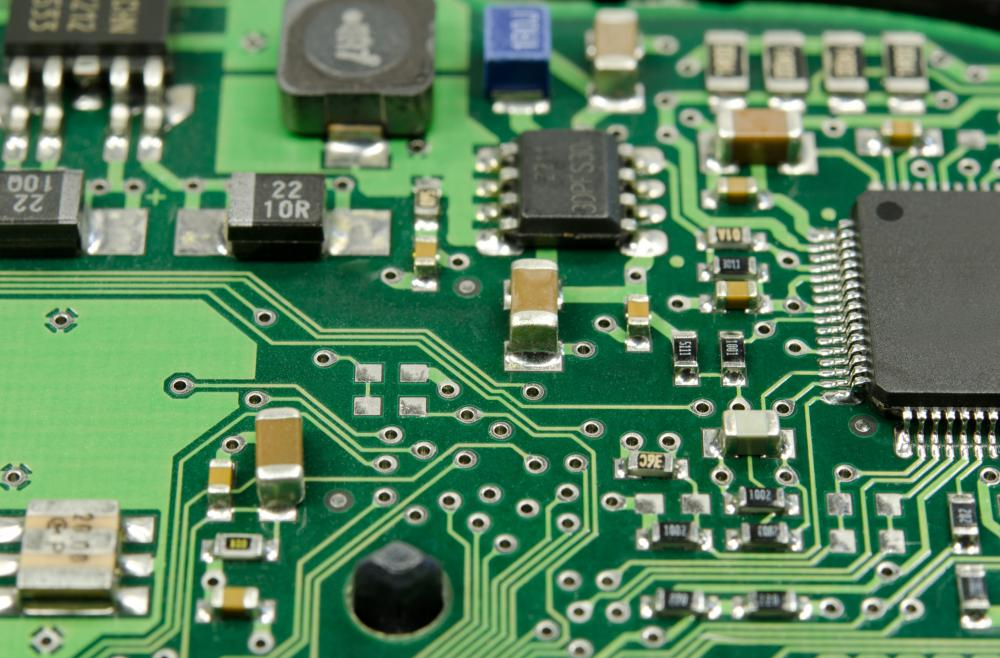 A printed circuit board holds tiny electronic components.