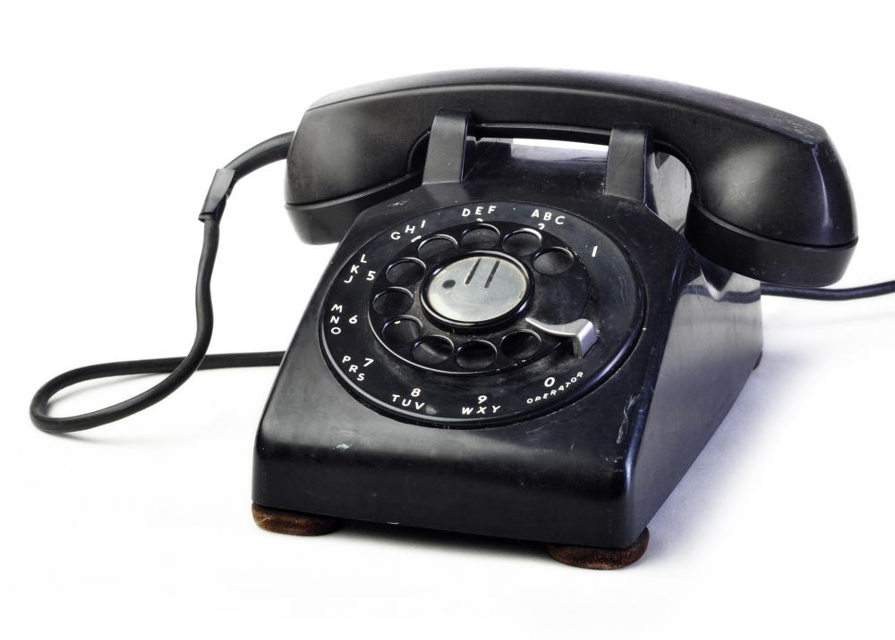 A rotary telephone, the precursor to a touch tone telephone.