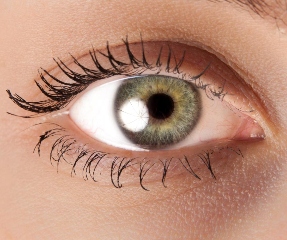 After damage to the posterior pole, symptoms like blurred vision and dark spots may occur.