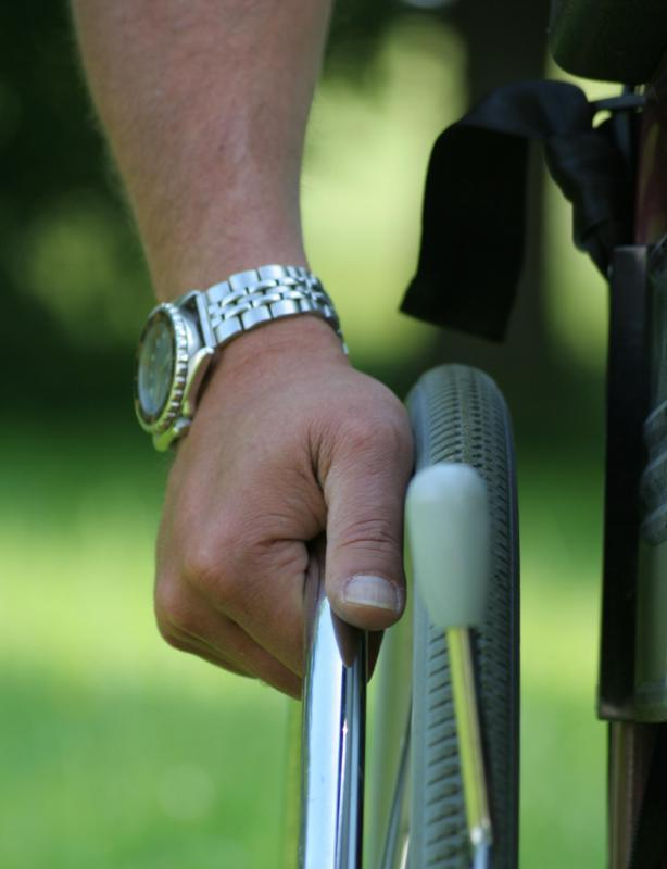 Disability etiquette states it is impolite to touch a person's wheelchair without permission.