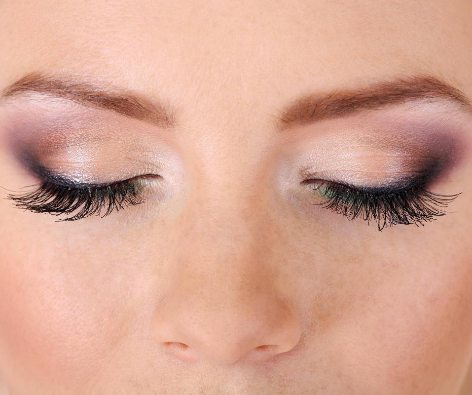 Liquid eyeliner can be applied to make a person's eyes look bigger.