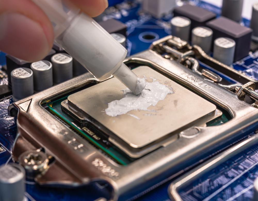 Thermal grease helps keep a CPU cool by covering imperfections in a heat sink.