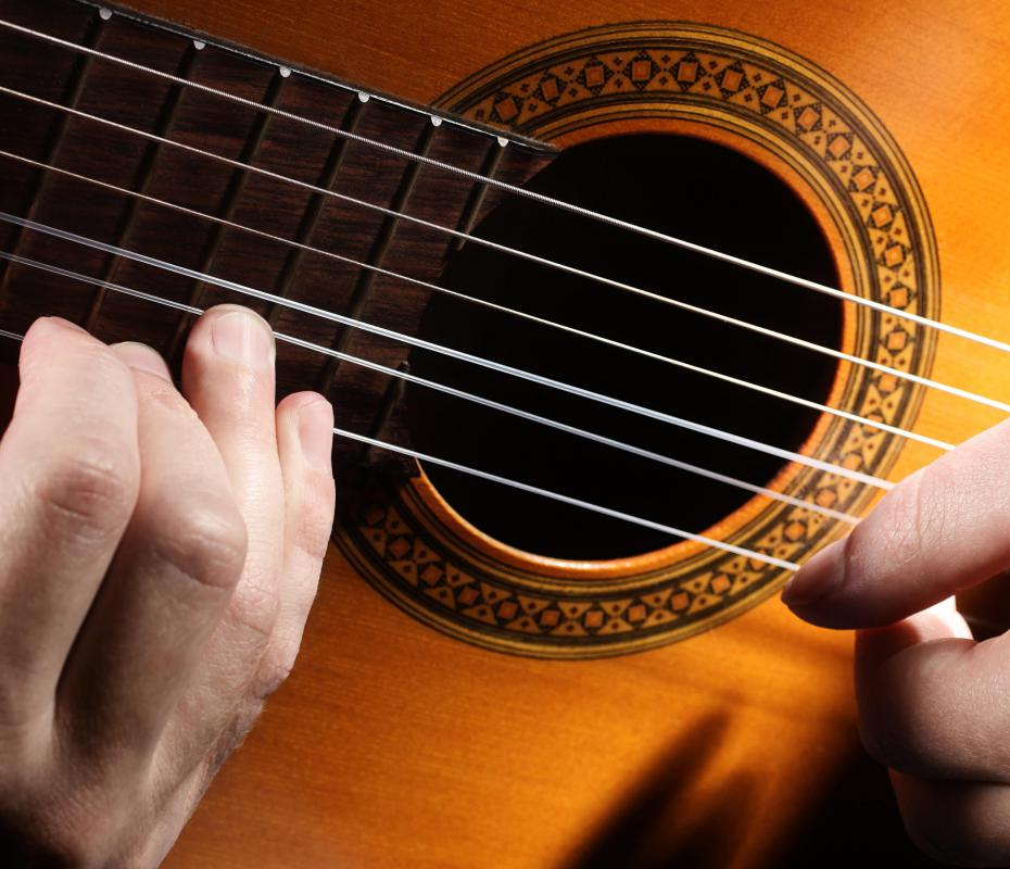 Most acoustic and electric guitar strings are made of steel.