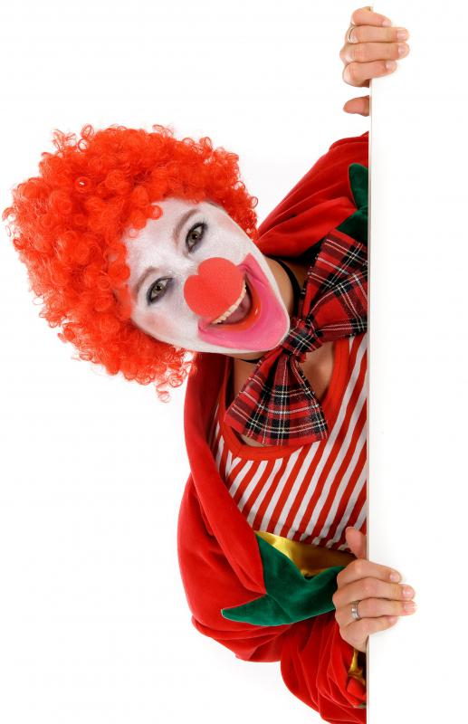 A clown wearing a fancy dress wig.